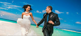 wedding-couple-running-in-the-water.jpg