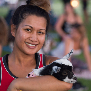 Woman-holding-baby-goat-in-yoga_edited.p