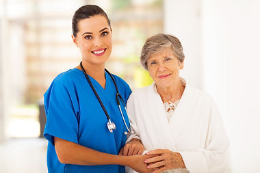 senior woman and caring young nurse.jpg