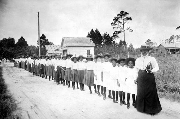 Bethune and her students outside of Daytona Institute in 1905. Photo Credit: Florida State Archives Photographic Collection, Public Domain prof magazine