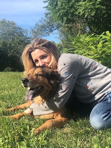dr. lissa altschuler hugging her dog in the grass