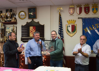 The Maltese Center President Eddie Debono presenting Ambassador Carmelo Inguanez with parting gifts a a Commemoration plaque and the Maltese Center Logo 2019 Photo credit: Nicky Conti