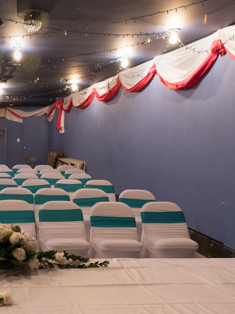 The lower hall prepared for a private ceremony event Photo Credit:Nicky Conti