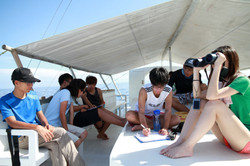Students reviewing their data onboard ou