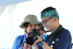 Students checking dolphin photo-IDs