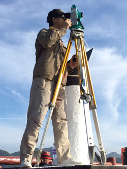 Simon using theodolite for dolphin track