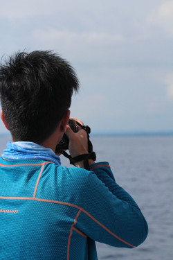 Stephen Chan taking photos at dolphin
