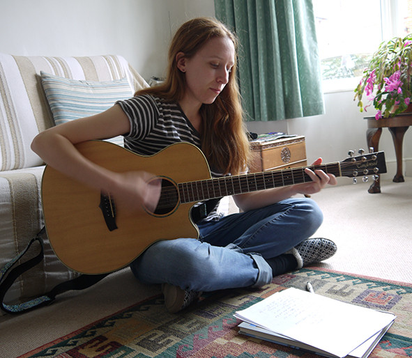 woman songwriting