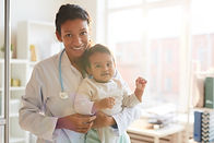doctor-with-baby-at-hospital-ADSDWQ4.jpg