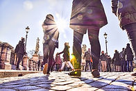 crowd-of-people-walking-under-the-sun-on