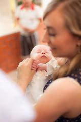 Little girl on ceremony of child christe
