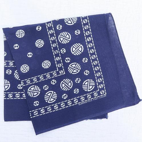 Folded vintage dark blue bandana with round circles