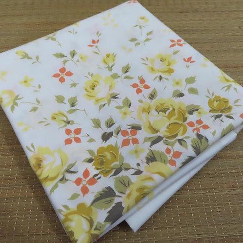 Vintage white pillowcase with yellow rose print