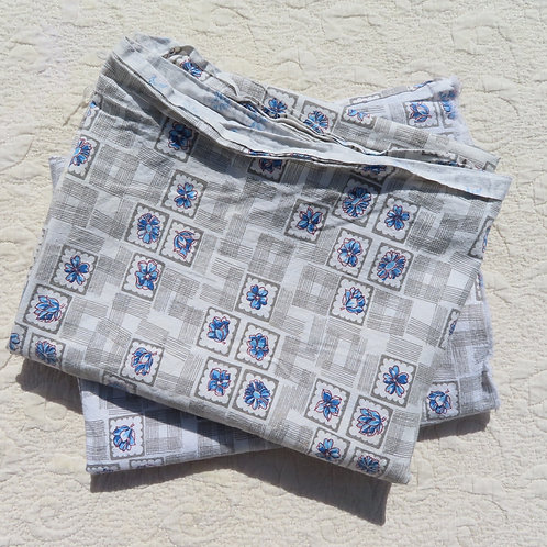 Two vintage fabric feedsacks in gray and blue floral print