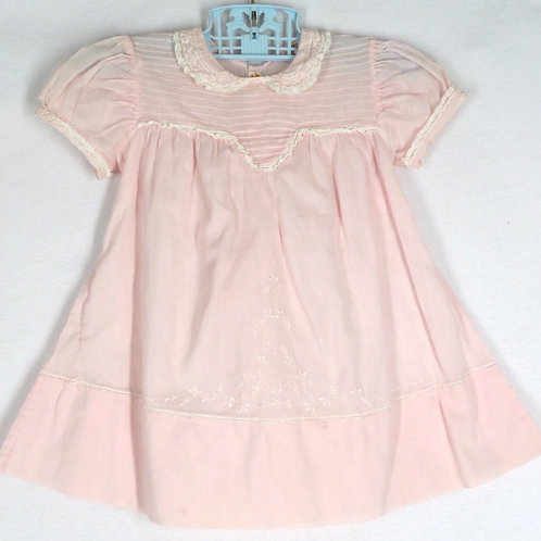 Vintage pink baby dress with delicate tucks and embroidery