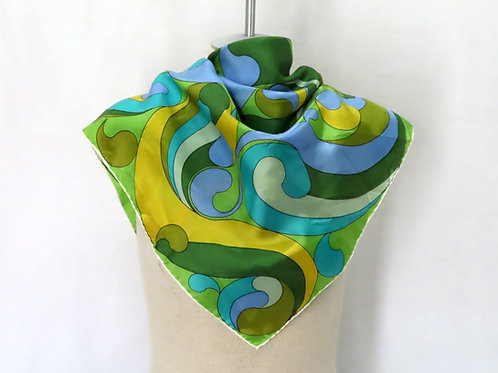 Vintage scarf on mannequin showing blue, green and yellow paisley motif