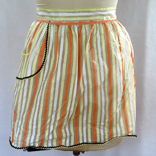 Sheer plastic waist apron from the 60s has orange, yellow and white stripes