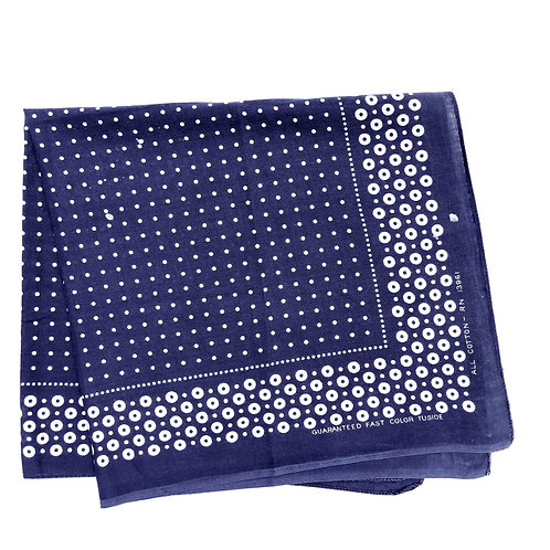 Folded dark blue Tuside bandana with white polka dot print