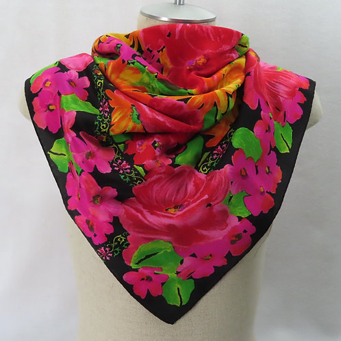 Black and bright floral scarf on a mannequin