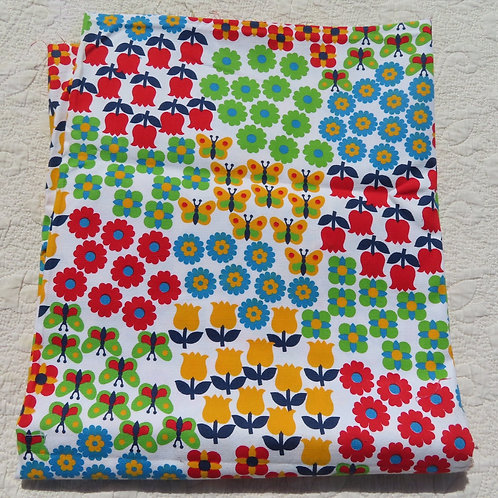 Colorful retro fabric with a patchwork butterfly and flower print