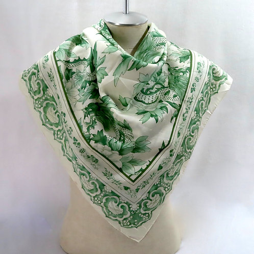 Green and white print Ralph Lauren scarf shown on mannequin