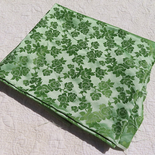 Vintage green shiny damask fabric with roses