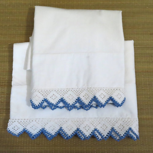 Pair vintage white cotton pillowcases with blue and white crochet lace edging