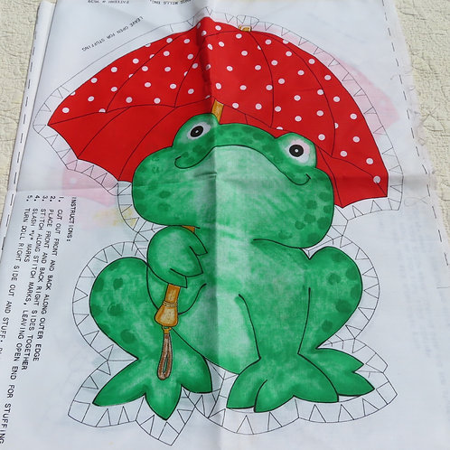Vintage fabric cutouts featuring a green frog holding a bright red polka dot umbrella
