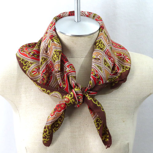 brown paisley print scarf shown on mannequin