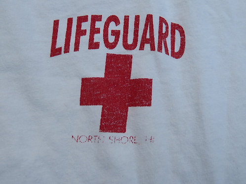 Vintage white lifeguard tee with red cross and North Shore Hi text