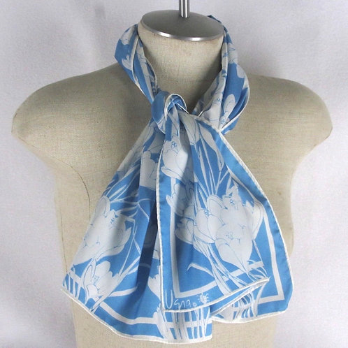 Pretty blue floral scarf by Vera, shown tied at neck on mannequin