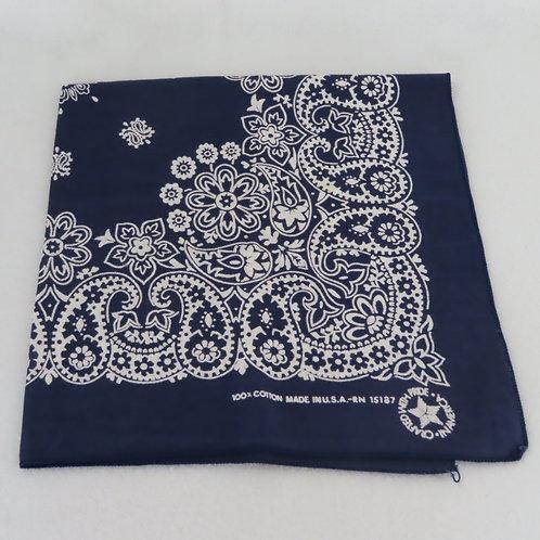 Dark blue with white paisley print bandana, folded into a square