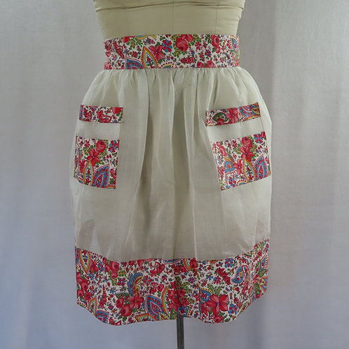 Vintage gathered waist style apron with floral trim at the hem, pockets and waistband