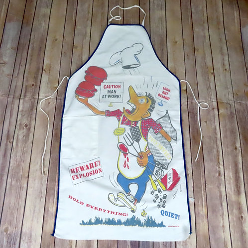 Vintage white apron from the 1950s features a harried chef juggling various items