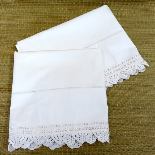 Vintage solid white pillowcases with hand crochet lace trim at the hem
