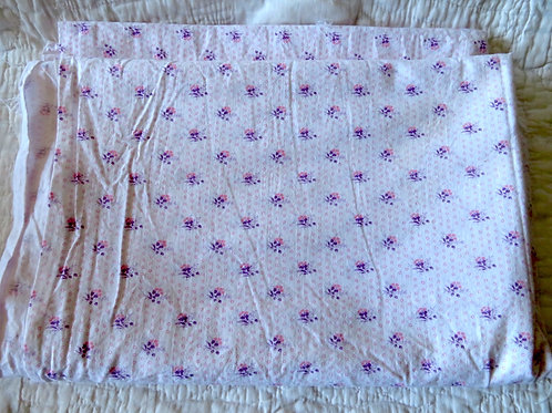 White cotton fabric with ditsy pink and purple floral print