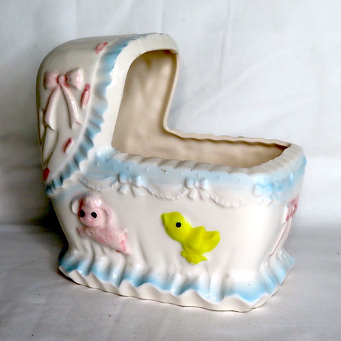 Vintage ceramic baby cradle shaped planter with zoo animals