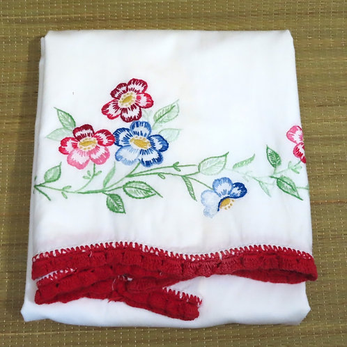 Vintage embroidered pillowcase with red flowers and crochet lace