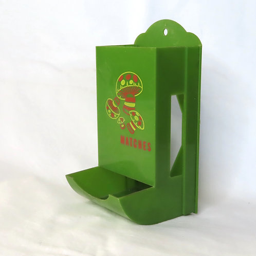 Green plastic match keeper or match safe with orange mushrooms