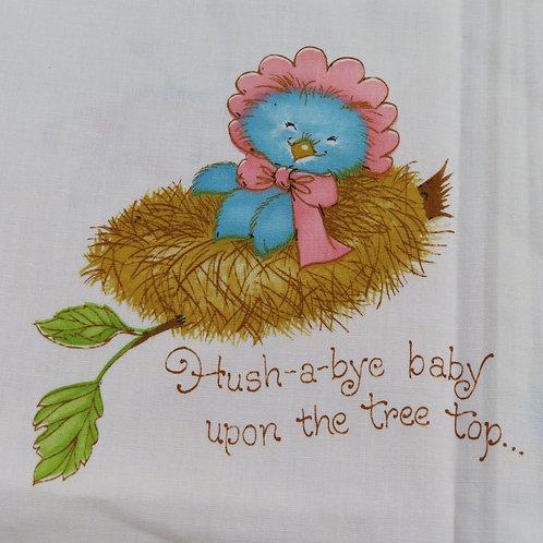 Fabric with rockabye baby bird in a nest