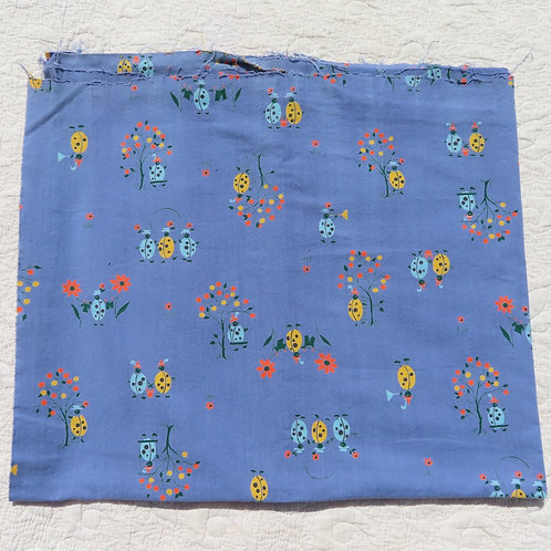 Vintage blue fabric with colorful ladybug print