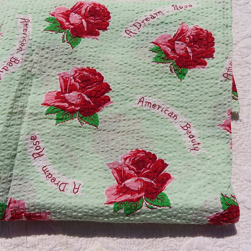 Closeup red roses on green fabric