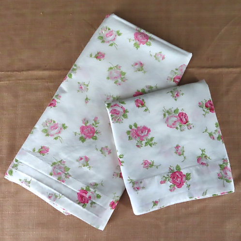 Two white cotton pillowcases with pink rose floral print