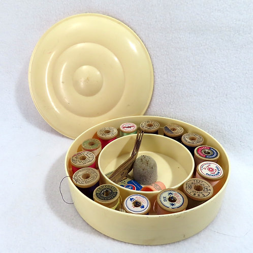 Vintage round thread caddy, sewing thread and notions