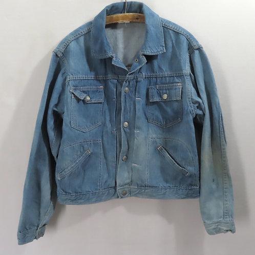 Vintage blue denim jeans jacket hanging on a hanger