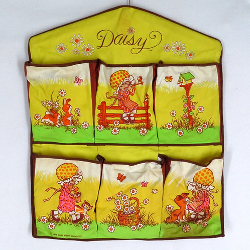 Vintage yellow and green Daisy girl wall pocket by Kirby Martin