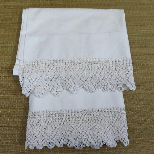 Two vintage white cotton pillowcases