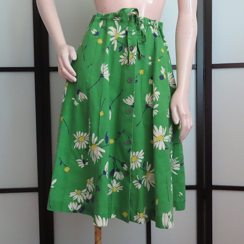 Green and white daisy print skirt shown on mannequin