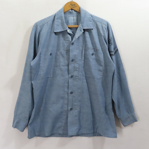 Blue chambray long sleeved shirt with navy emblem on the sleeve