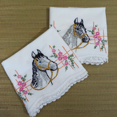Pair of vintage white cotton pillowcases embroidered with horse head image and flowers